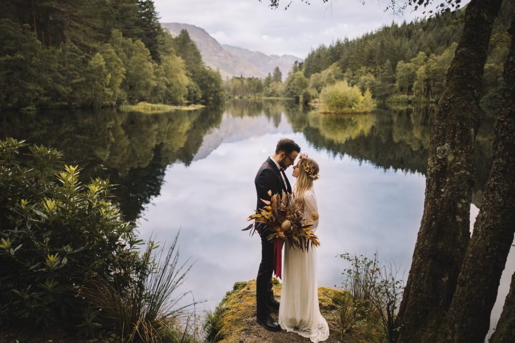 Bride and groom looking lovingly at each other at Glencoe Lochan during an elopement